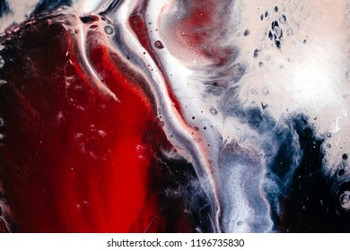 Abstract red paint background. Acrylic texture with marble pattern