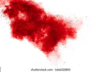 Abstract red powder explosion on white background. Red powder explosion.Freeze motion of red dust particles splash.