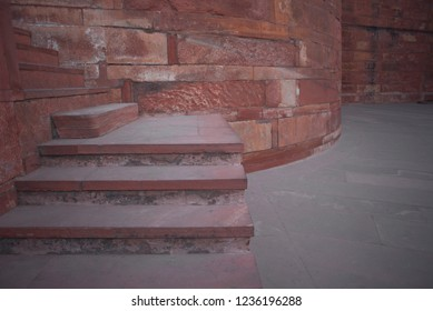 Abstract of the red stone architecture of the steps and the strong walls of the Agra Fort also called as the Red Fort a mughal architectural splendor and once a Mughal Dynasty residence