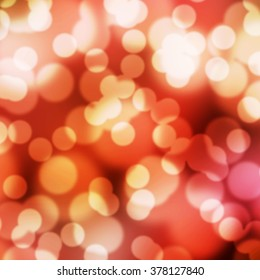 The abstract red tone bokeh background