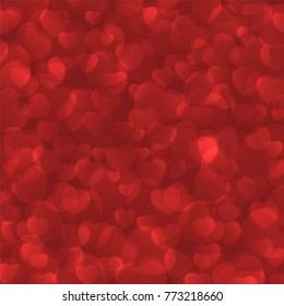 Abstract red Valentine's day bokeh background decorated with hearts.