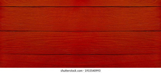 Abstract red wooden background for your holiday advertising. The texture of the tree. Top view. Banner with copy space