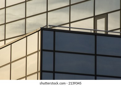 abstract reflecting windows on large business building