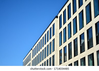 Abstract reflection of modern city glass and steel facades. Modern office building detail, glass and steel surface.