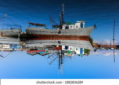 Abstract reflection of a small cuban Fishing-Boat in port