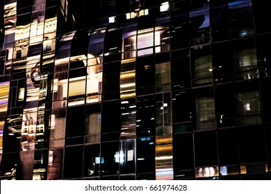 Abstract reflections at night in glass skyscraper windows