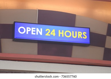 Abstract resembling 24 hours neon sign - suitable for night time retail concepts.