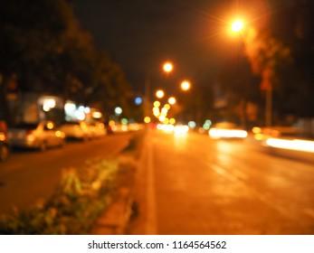 Abstract road night light bokeh, Defocused background, Defocused night city life.