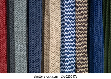 abstract row of woven coloured belts making an unusual background pattern