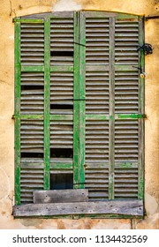 Abstract Rustic Background Of Old Broken Window Shutters On A Spanish Villa
