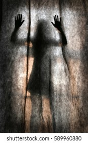 abstract scary human body silhouette woman in the short skirt in front of window behind the black curtain