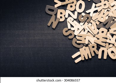 Abstract scattered wood letters on corrugated background