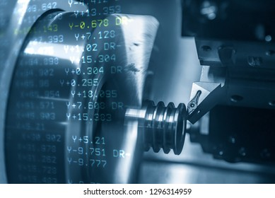 The abstract scene of CNC lathe machine and the NC data.The CNC lathe machine cutting the steel shaft with lighting effect and G-code data in background.