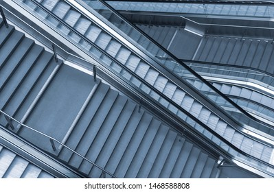 Abstract scene of a staircase combined with escalators