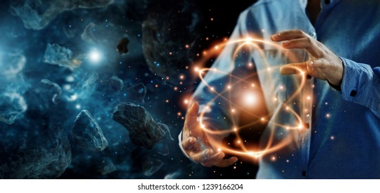 Abstract science, hands holding atomic particle, nuclear energy imagery and network connection on meteorites space planets background.