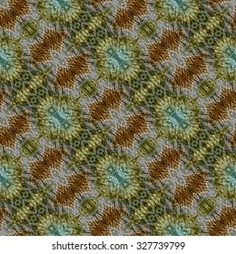 Abstract seamless pattern with wrinkled structure and green, yellow and red geometric ethnic motifs