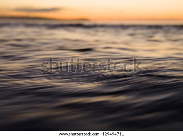 Abstract seascape at sunset in a beach.