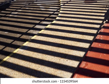 Abstract shadow of steel structure on the ground creating modern art