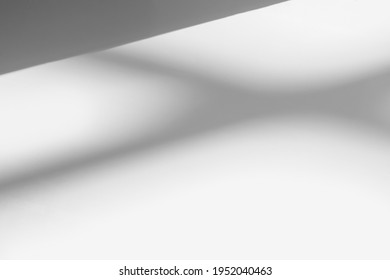 Abstract shadow and striped diagonal light blur background on white wall  from window,  architecture dark gray and sunshine diagonal geometric effect overlay for backdrop and mockup design