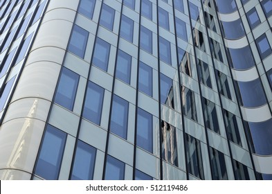 abstract shapes of modern buildings made of steel and glass