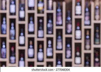 Abstract shelves with bottles of wine, shallow depth of focus