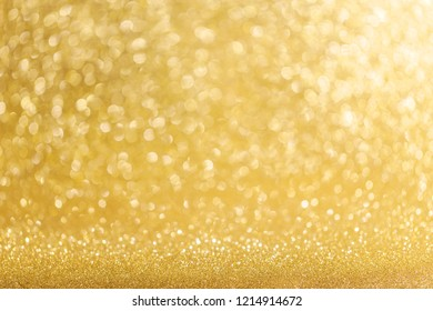 Abstract shining glitters gold holiday bokeh background with copy space for text