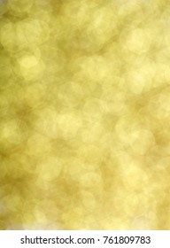 Abstract shining glitters gold holiday bokeh background with copy space