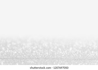 Abstract shining glitters silver holiday bokeh background with copy space for text