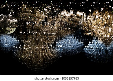 abstract shining light with chandelier crystal in dark night. Luxury star light in dark for nackground concept