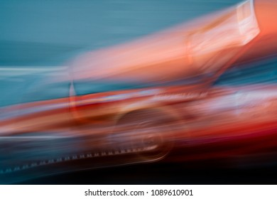 Abstract shot of car on the training race track. Extreme long exposure image.