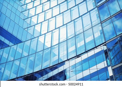 Abstract shot of modern building, with structural lines and reflection.