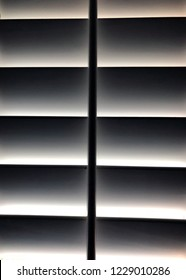 An abstract shot of plantation shutters with light just peaking through.