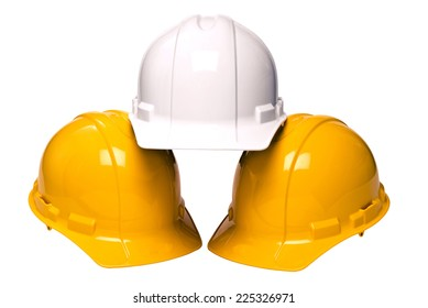 Abstract Shot Of Three Construction Helmets In A Pyramid On White Background