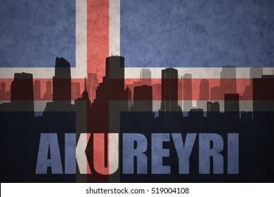 abstract silhouette of the city with text Akureyri at the vintage icelandic flag background