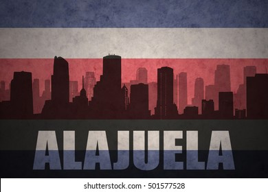 abstract silhouette of the city with text Alajuela at the vintage costa rican flag background