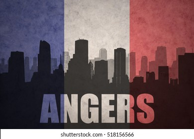 abstract silhouette of the city with text Angers at the vintage french flag background
