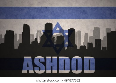 abstract silhouette of the city with text Ashdod at the vintage israel flag background
