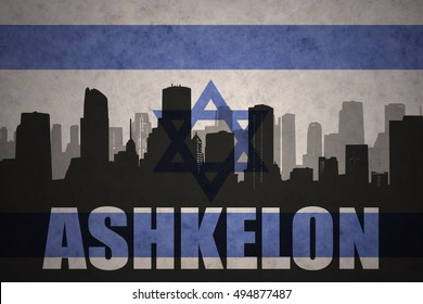 abstract silhouette of the city with text Ashkelon at the vintage israel flag background