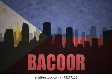 abstract silhouette of the city with text Bacoor at the vintage philippines flag background