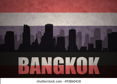 abstract silhouette of the city with text Bangkok at the vintage thailand flag background