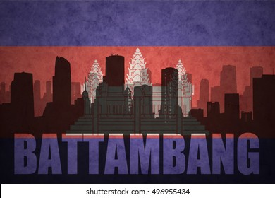 abstract silhouette of the city with text Battambang at the vintage cambodian flag background