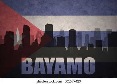 abstract silhouette of the city with text Bayamo at the vintage cuban flag background