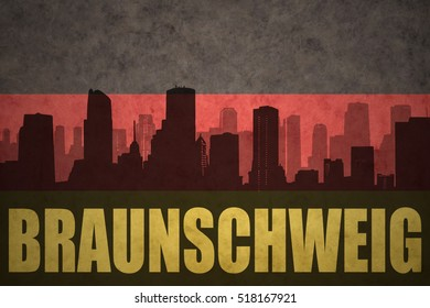 abstract silhouette of the city with text Braunschweig at the vintage german flag background