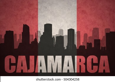 abstract silhouette of the city with text Cajamarca at the vintage peruvian flag background