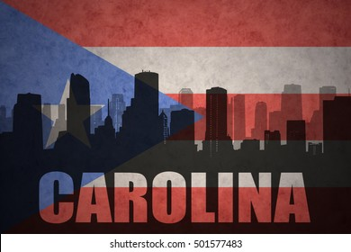 abstract silhouette of the city with text Carolina at the vintage puerto rican flag background