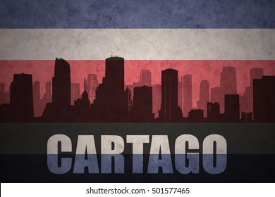 abstract silhouette of the city with text Cartago at the vintage costa rican flag background