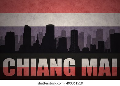 abstract silhouette of the city with text Chiang Mai at the vintage thailand flag background