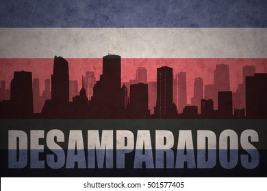 abstract silhouette of the city with text Desamparados at the vintage costa rican flag background