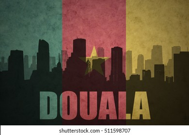 abstract silhouette of the city with text Douala at the vintage cameroon flag background
