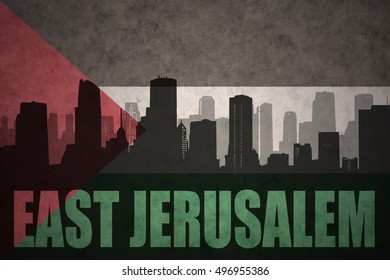 abstract silhouette of the city with text East Jerusalem at the vintage palestinian flag background